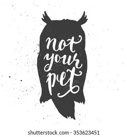 Lettering composition. Phrase Not your pet inscribed into owl silhouette. Ink splashes on white background.