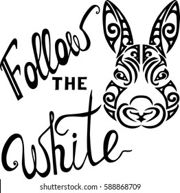 Lettering Follow the White Rabbit with a rabbit head stylized Maori face tattoo.