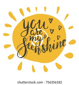 Lettering you are my sunshine. Hand drawn vector illustration, brushpen. Hand lettering quote for Vilentine day cards. Calligraphic inscription. Vector.