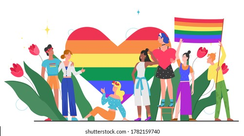 LGBT pride month concept vector illustration. Cartoon young group of lover people standing together, waving, holding rainbow heart and LGBT flag in hands, homosexual rainbow love isolated on white