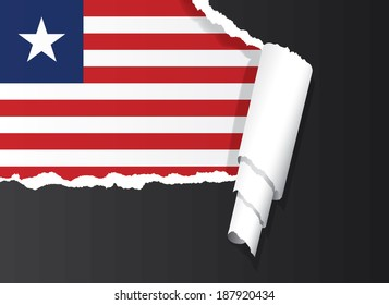 Liberian flag under ripped paper vector illustration.