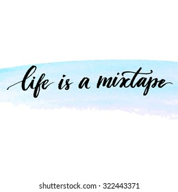 Life is a mixtape. Inspirational quote handwritten with modern calligraphy at delicate blue watercolor stroke. Vector lettering design for cards, prints and social media content.