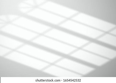 Light from arched windows on a white floor or surface. Template for design