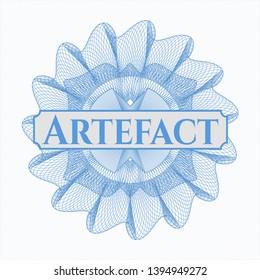 Light blue passport style rosette with text Artefact inside