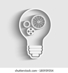 light bulb with gears and cogs working together