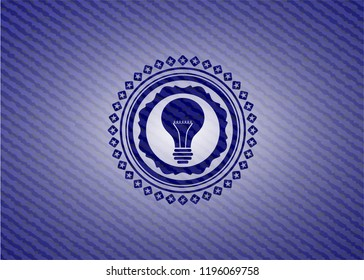 light bulb icon inside emblem with denim texture