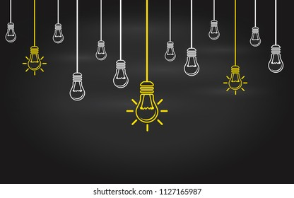 Light bulbs on a blackboard background. Creativity concept with innovation or inspiration in global business, thinking outside the box. Business strategy in startup. New leaderships on teamwork.