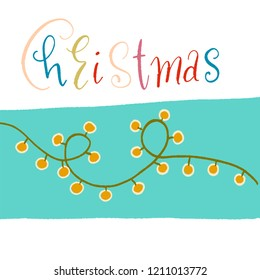 light garland with yellow lights on a blue background. the word Christmas in colored letters