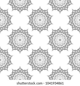 Light gray floral element on white background. Seamless pattern for textile and wallpapers