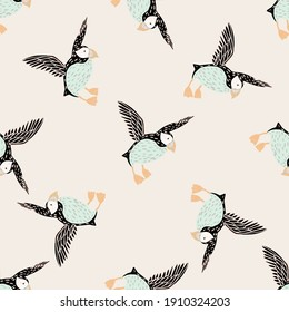 Light tones seamless pattern with hand drawn doodle puffin bird silhouettes. Pink pastel background. Flat vector print for textile, fabric, giftwrap, wallpapers. Endless illustration.
