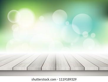 Light wooden background against a bokeh lights background