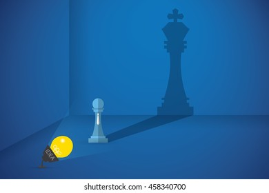 lightbulb flash the pawn chess to shows big shadow of king chess, idea and business concept