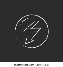 Lightning arrow downward hand drawn in chalk on a blackboard vector white icon isolated on a black background.