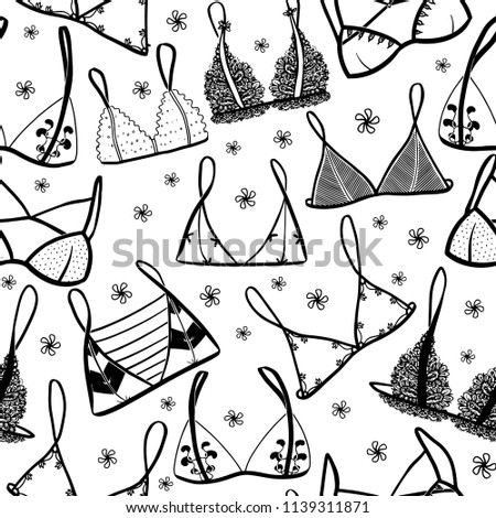Lingerie seamless pattern. Hand drawn vector underwear background for your design and print. Outline black and white illustration. Bras and panties doodle. Fashion feminine wallpaper.