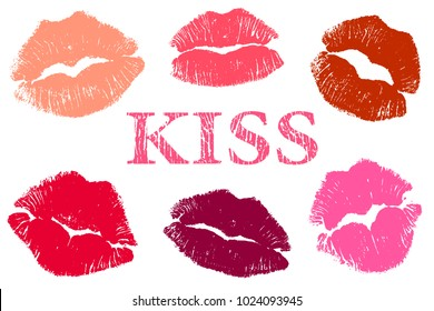 The lip prints of different women around the word kiss on a white background.