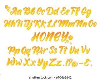 Liquid honeyed latin alphabet with gold splashes. Hand writing yellow letters vector set