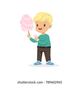Little blond boy with sweet cotton candy. Cartoon kid character wearing green sweater and brown pants. Flat vector design