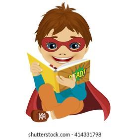 little boy dressed as a superhero reading a comic book