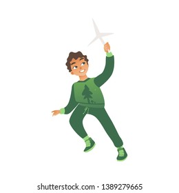 A little boy in green clothes runs with a toy windmill in his hands. Eco children concept, isolated vector illustration on white background.