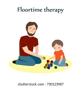 Little boy and a his father sitting on a floor and playing with blocks. Floortime therapy correction technique, used for teaching kids, especially for children with ASD or autism