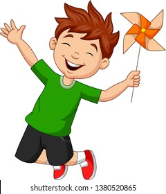 Little boy jumping with a paper windmill