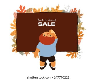 Little boy musingly looks up at a chalkboard surrounded with autumn leaves