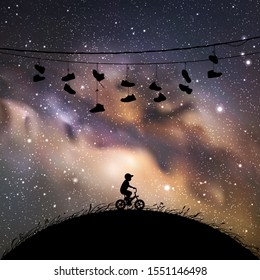 Little boy on bicycle at night. Vector illustration with silhouette of lonely boy on bike. Shoes hanging on wires. Space dark background with starry sky and Milky Way