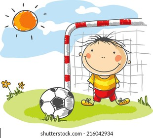 Little boy playing football as a goalkeeper