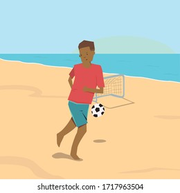 Little boy playing soccer at the beach