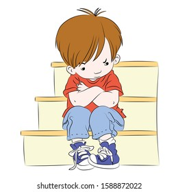 A little boy sitting on the stairs lonely, sad, upset and angry. Feelings of a child