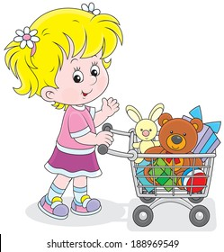 Little buyer going with a supermarket trolley filled with toys