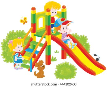 Little children playing on a slide at a playground