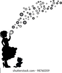 Little girl in big shoes with soap bubbles