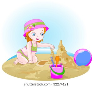 Little girl building a sand castle at the beach