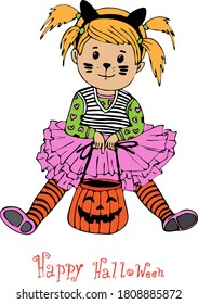 little girl child sitting in dress cats face is painted with a basket of candy for Halloween