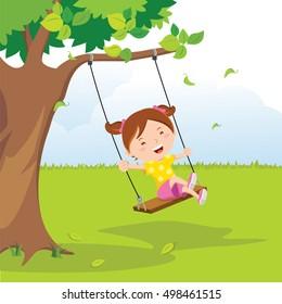 Little girl on swing under a tree