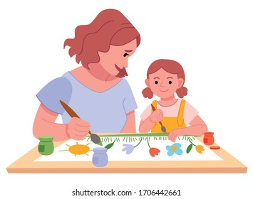 Little girl painting with her mother. mother teaches daughter paint .Mother with kid painting and have fun pastime .Cute funny mom and child performing recreational art activity.