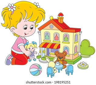 Little girl playing with a small doll, bear, rabbit in a toy house