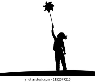 Little girl playing with wind toy or pinwheel. Happy girl silhouette