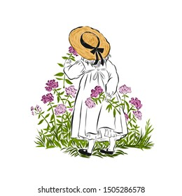 Little girl in straw hat sniffs flowers standing back and holding one torn flower in hand. Summertime garden.