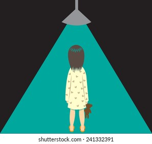 A little girl is under a beam of green light