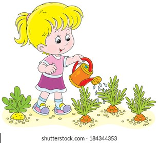 Little girl watering vegetables in a kitchen garden