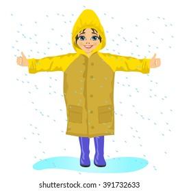little girl wearing yellow raincoat in the rain