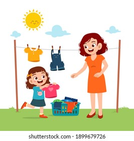 little kid helping mother to dry the clothes outside