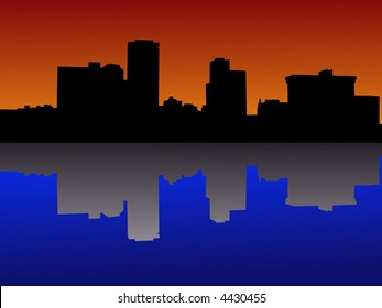 Little Rock skyline at sunset reflected in river
