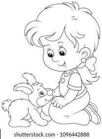 Little smiling girl playing with her small rabbit, black and white vector illustration in a cartoon style for a coloring book