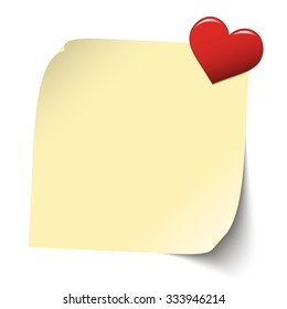 little yellow sticky paper with red heart pin