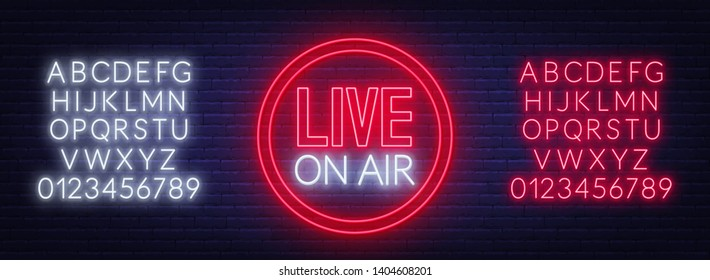 Live on air glowing sign on brick wall background. Template for design. Neon alphabet .