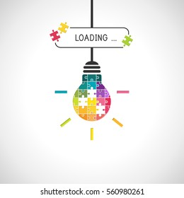 Loading idea concept with light bulb made of colorful puzzle pieces