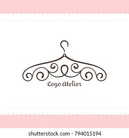 Logo for Atelier, wedding boutique, women's clothing store. Vector template of the brand for the fashion designer. Element for Studio sewing and tailoring. Hanger with graceful lines